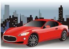 Carro vermelho na cidade Imagens de Stock Royalty Free