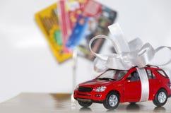 Carro vermelho na fita branca imagens de stock royalty free