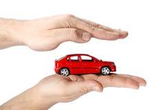 Carro vermelho nas mãos Imagem de Stock