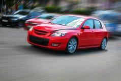 Carro vermelho no movimento Fotografia de Stock Royalty Free