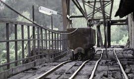 Carro viejo de la explotación minera con la lámpara Fotos de archivo libres de regalías