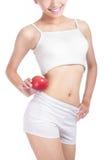 Carrocería atractiva joven de la mujer y manzana roja Imagen de archivo libre de regalías