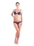 Carrocería completa de una mujer joven en un bikini gris Fotos de archivo libres de regalías