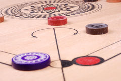 Carrom board (HIT). Carom striker waiting for shoot out next hit Royalty Free Stock Photo