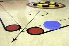 Carrom board with striker and coins Stock Photo