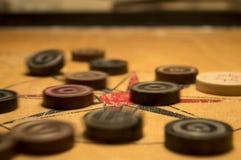 Carrom-Münzen stockfotografie