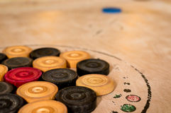 Carrom men pieces arranged on a board Royalty Free Stock Images