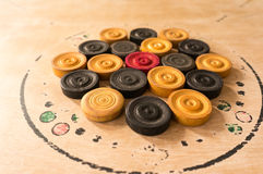 Carrom men pieces arranged on a board Royalty Free Stock Photo