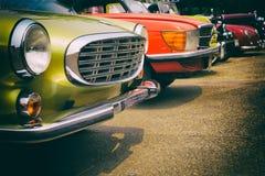 Carros clássicos em seguido Imagem de Stock