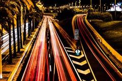 Carros da luz da noite fotos de stock