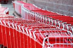 Carros de compra vermelhos Fotografia de Stock