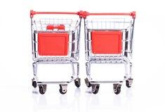 Carros de compras del adulto y de los niños Fotos de archivo libres de regalías