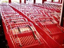 Carros de compras rojos Imágenes de archivo libres de regalías