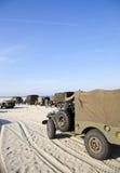 Carros de ejército en la playa Fotografía de archivo libre de regalías