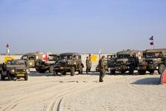 Carros de ejército en la playa Imagen de archivo libre de regalías