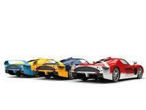 Carros de esportes impressionantes do conceito em cores vermelhas, azuis e amarelas - opinião da retaguarda Fotografia de Stock