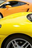 Carros de esportes italianos em amarelo e na laranja Imagens de Stock Royalty Free