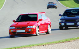 Carros de esportes no circuito Foto de Stock Royalty Free