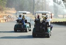 Carros de golfe fotografia de stock royalty free