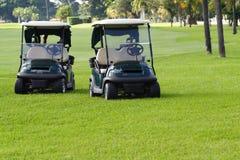 Carros de golfe Fotos de Stock