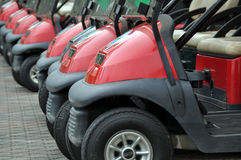 Carros de golfe vermelhos Imagens de Stock