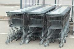 Carros de la compra alineados imagen de archivo libre de regalías