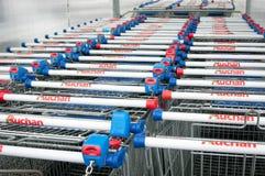 Carros de la compra de Auchan imagen de archivo libre de regalías