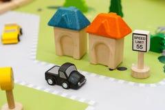 Carros de madeira coloridos fotografia de stock royalty free