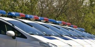 Carros de polícia com as sirenes vermelhas e cor azul Imagem de Stock Royalty Free