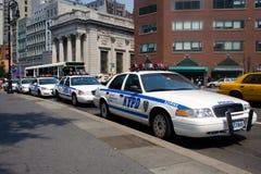 Carros de polícia em New York City imagens de stock