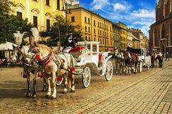 Carros del caballo en Cracovia Imágenes de archivo libres de regalías