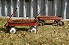 Carros del rojo de los niños del vintage Fotografía de archivo