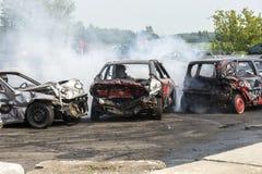 Carros destruídos na ação Imagem de Stock