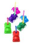 Carros do brinquedo com velas do aniversário Fotografia de Stock Royalty Free