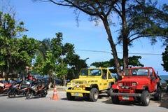 Carros e velomotor para o aluguel Fotografia de Stock