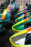 Carros elétricos no parque de diversões Fotografia de Stock