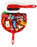 Carros em um dustpan Foto de Stock Royalty Free