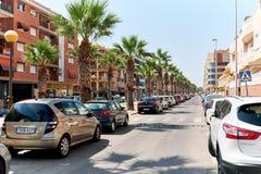 Carros estacionados na rua Imagens de Stock
