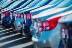 Carros estacionados sobre muito Imagem de Stock Royalty Free