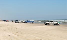 Carros na praia do console de Padre fotos de stock