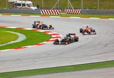 Carros na trilha na raça da fórmula 1 Imagem de Stock Royalty Free
