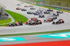 Carros na trilha na raça da fórmula 1 Foto de Stock