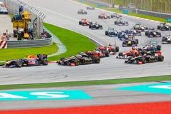 Carros na trilha na raça da fórmula 1 Imagem de Stock