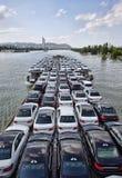 Carros novos em um barco imagens de stock royalty free