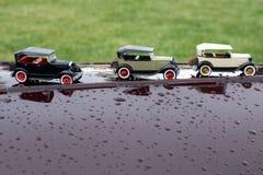 Carros pequenos na capa do carro Imagem de Stock Royalty Free