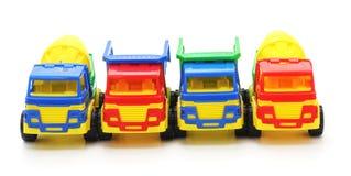Carros plásticos do brinquedo fotos de stock