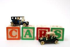 Carros pretos antigos em blocos do ABC Fotografia de Stock Royalty Free