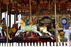 Carrossel do parque de diversões no cais da praia de Brigghton Fotos de Stock Royalty Free