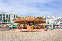 Carrossel no passeio da praia de Brigghton Foto de Stock Royalty Free