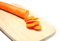 Carrot. A carrot on a board Royalty Free Stock Images